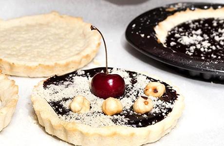 Receta de tartelettes de chocolate, frutos rojos y avellanas